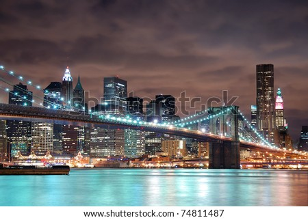 New York City Manhattan panorama view with Brooklyn Bridge at night with office building skyscrapers skyline illuminated over Hudson Rive #74811487
