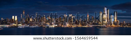 New York City (Manhattan) panoramic view at dusk from the Hudson River. The view includes the skyscrapers of Midtown West (Hudson Yards redevelopment project). NYC, NY, USA Stock photo ©
