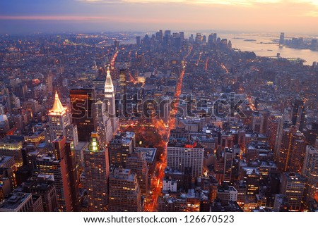 New York City Manhattan skyline aerial view panorama at sunset with skyscrapers and street.