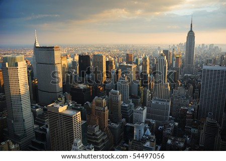 New York City Manhattan skyline aerial view with Empire State and skyscrapers at sunset. #54497056