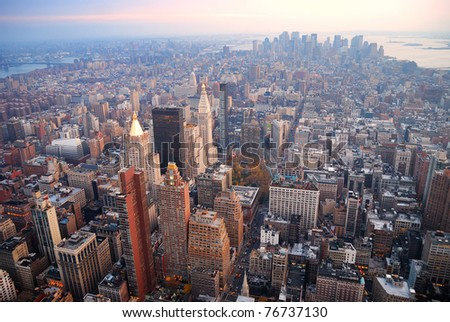 New York City Manhattan skyline aerial view with street and skyscrapers at sunset.