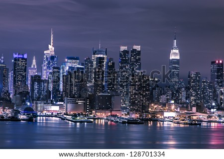 New York City Manhattan skyline panorama at night over Hudson River