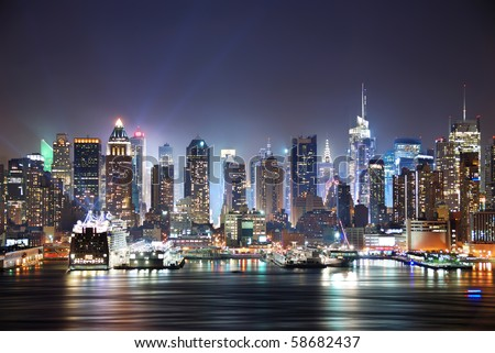 New York City Manhattan skyline panorama at night over Hudson River with refelctions viewed from New Jersey #58682437