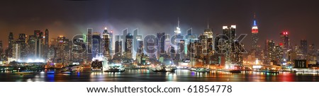 New York City Manhattan skyline panorama at night over Hudson River with refelctions viewed from New Jersey #61854778