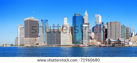 New York City Manhattan skyline panorama in the morning with skyscrapers over Hudson River with blue sky. #71960680