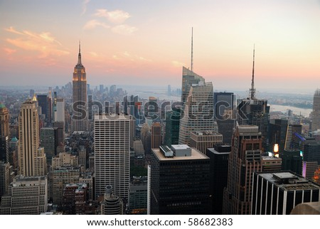 New York City Manhattan skyline panorama with Empire State Building and skyscrapers at sunset