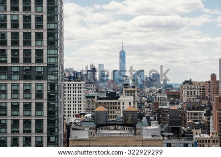 New York City Manhattan skyline with cloudy sky. High saturated filtered image. #322929299