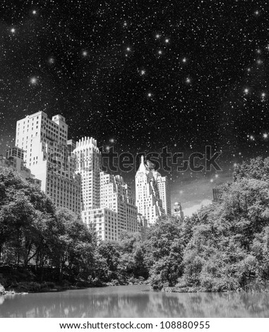 New York City - Manhattan Skyscrapers from Central Park with Trees and Lake. - stock photo