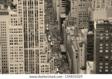 New York City Manhattan street aerial view black and white with skyscrapers, pedestrian and busy traffic.