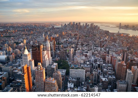 New York City Manhattan sunset skyline aerial view with office building skyscrapers and Hudson River.