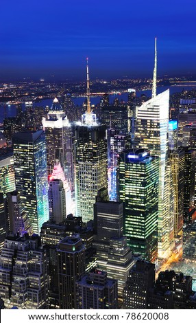 New York City Manhattan Times Square night city skyline aerial view with urban skyscraper illuminated.