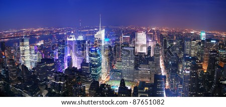 New York City Manhattan Times Square skyline aerial view panorama at night with skyscrapers and street. - stock photo