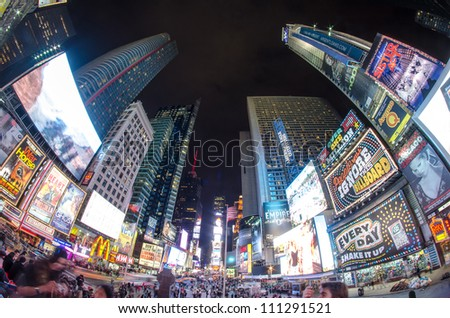 NEW YORK CITY - MAR 15: Times Square, featured with Broadway Theaters and animated LED signs, is a symbol of New York City and the United States, March 15, 2010 in Manhattan, New York City