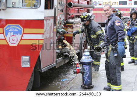 NEW YORK CITY - MARCH 27 2015: one day after a fire & explosion in Manhattan\'s East Village, two people remain missing while emergency personnel clear the wreckage of three destroyed brownstones
