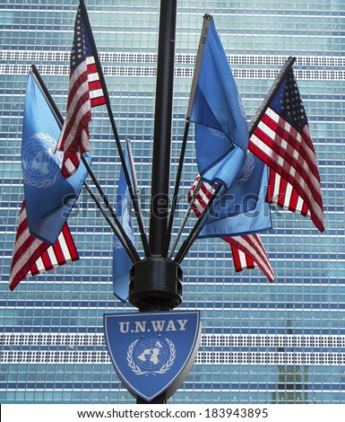 NEW YORK CITY - MARCH 20: United Nations and United States Flags in the front of UN Headquarter in New York on March 20, 2014
