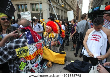 NEW YORK CITY - MAY 1: Occupy Wall Street activists display diversity of culture & form as they march into Soho along Broadway in honor of International Workers' Day  May 1 2012 in New York City