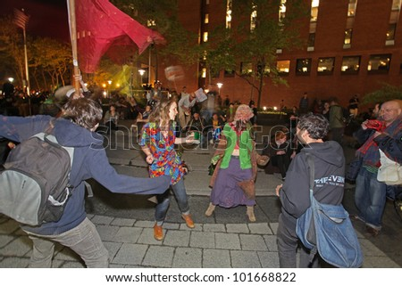 NEW YORK CITY - MAY 1 : Occupy Wall Street members rally at Veterans' Memorial Park in Lower Manhattan & dance to the sound of drums on May 1 2012 in New York City.