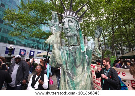 NEW YORK CITY - MAY 1 : Occupy Wall Street members wrangle their own Statue of Liberty in Bryant Park before marching in honor of International Workers' Day  on May 1 2012 in New York City