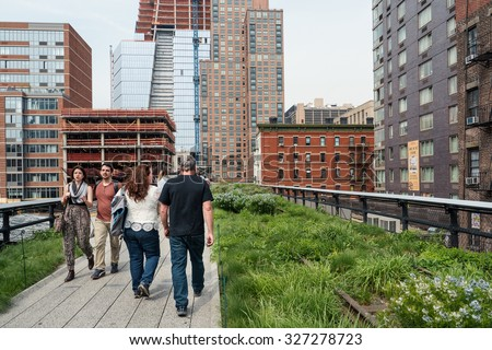 NEW YORK CITY - MAY 16, 2015: People relaxing on the High Line Park. The High Line is a park built on an historic freight rail line elevated above the streets in the West Side.