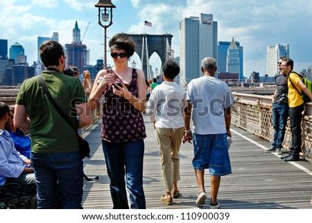 NEW YORK CITY-MAY 31, 2009: People walking across the Brooklyn Bridge. More than 4,000 pedestrians and 2,600 bicyclists cross the bridge every day, according to the NYC Dept. of Transportation.