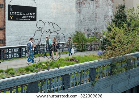 NEW YORK CITY - MAY 6, 2015: People walking on the High Line Park. The High Line is a park built on an historic freight rail line elevated above the streets in the West Side.