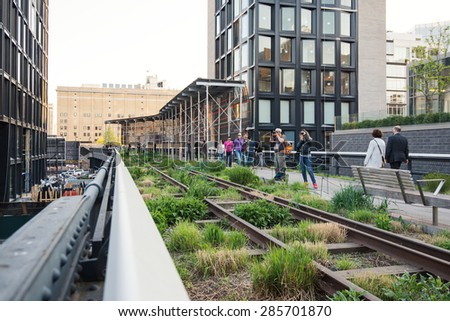 NEW YORK CITY - MAY 2015: People walking on the High Line Park. The High Line is a park built on an historic freight rail line elevated above the streets in the West Side.