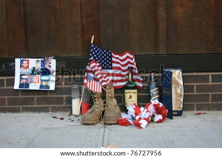 NEW YORK CITY - MAY 7: Personal memorial  left at Firehouse 10 next to Ground Zero following the announcement of the death of Osama Bin Laden on May 7, 2011 in New York, New York.
