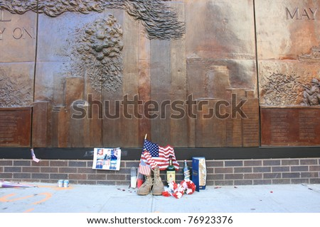 NEW YORK CITY - MAY 7: Personal memorial left at Firehouse 10 next to Ground Zero following the announcement of the death of Osama Bin Laden on May 7, 2011 in New York, New York
