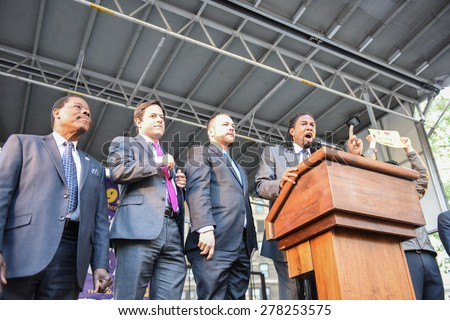 NEW YORK CITY - MAY 14 2015: several thousand tenants along with city council & state assembly members staged a march across the Brooklyn Bridge for affordable housing. NY City Council members