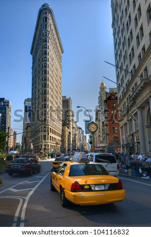 NEW YORK CITY - MAY 16: The Flatiron Building May 16, 2012 in New York, NY. Finished in 1902, the landmark skyscraper was designated a City Landmark in 1966 and a National Historic Landmark in 1989. - stock photo