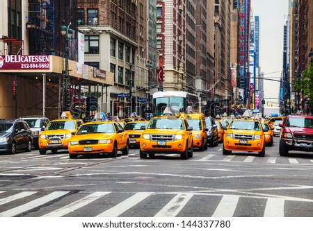 NEW YORK CITY MAY 11 Yellow taxis at the street on May 11 2013 in New York Yellow cars serve as taxis in NYC and are easy to spot among other vehicles because of their color