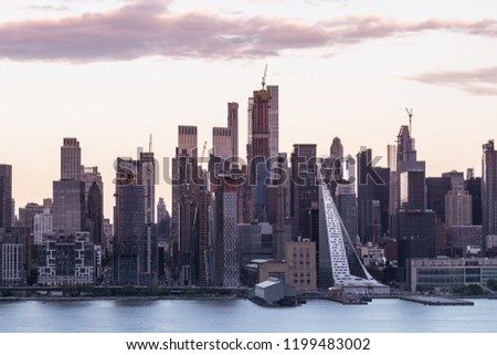 New York City midtown Manhattan sunset skyline panorama view from Boulevard East Old Glory Park over Hudson River. #1199483002