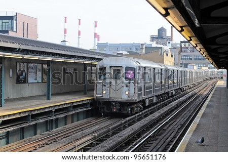 NEW YORK CITY, NEW YORK - MAY 28:  The No. 7 subway train arrives at the Court Street elevated station on May 28, 2011 in NYC, NY. It has run between Times Square and Main Street, Queens since 1948. - stock photo