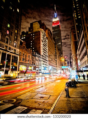 stock photo new york city nov empire state building in red white and blue colors at night is a draw to 133200020 - Каталог — Фотообои «Улицы, переулки»