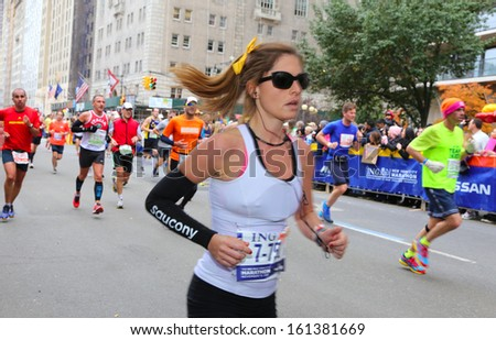 NEW YORK CITY - NOVEMBER 3 2013: the 42nd IMG New York City Marathon commenced after a one year hiatus due to Hurricane Sandy. Female runner finishing last mile November 3 2013 in New York City.