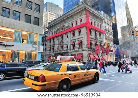 NEW YORK CITY, NY - DEC 30: Yellow taxi on Fifth Avenue on December 30, 2011 in New York City. With world class retail stores, it was ranked the world's most expensive retail spaces by Forbes in 1998