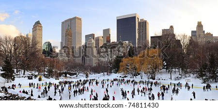 NEW YORK CITY, NY - JAN 1: People skate on ice with white Christmas in Central Park to welcome the new year of 2010 on January 1, 2011 in Manhattan, New York City.