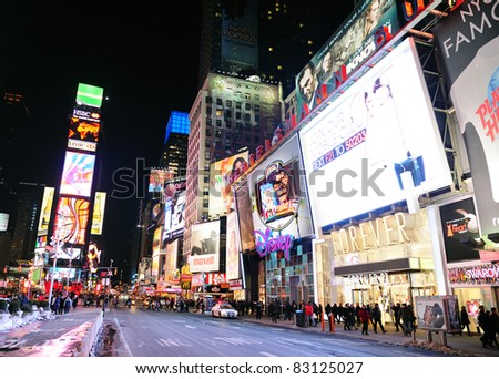 NEW YORK CITY, NY - JAN 30: Times Square at night on  January 30, 2011 in Manhattan, New York City. Times Square is featured with Broadway Theaters and LED signs as a symbol of New York City. - stock photo