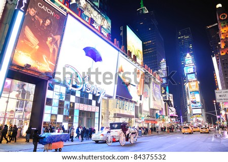 NEW YORK CITY, NY - JAN 30: Times Square at night on January 30, 2011 in Manhattan, New York City. Times Square is featured with Broadway Theaters and LED signs as a symbol of New York City.