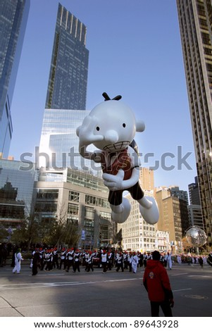NEW YORK CITY, NY - NOVEMBER 24: Diary of a Wimpy Kid Balloon over people below in Macy's 85th Annual Thanksgiving Day Parade on November 24, 2011 in New York City, New York. - stock photo