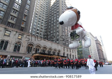 NEW YORK CITY, NY - NOVEMBER 24: Snoopy from Peanuts balloon floats in the Macy's 85th Annual Thanksgiving Day Parade on November 24, 2011 in New York City, New York.