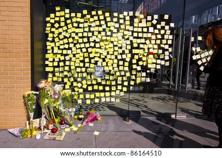 NEW YORK CITY, NY - OCTOBER 7: Sidewalk memorial and Post-it note farewells at the Apple Store in NYC on October 7, 2011 mark the death of Steve Jobs. The iconic CEO of Apple died Oct. 5th 2011.