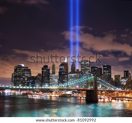 NEW YORK CITY, NY - SEP 11: City night view with light beam on September 11, 2010 in Manhattan, New York City. Light beams are lit at the site in memory of World Trade Center.