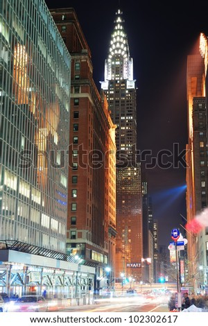 NEW YORK CITY, NY, USA - DEC 30: Chrysler Building at night with street on December 30, 2011, New York City. It was designed by architect William Van Alena as Art Deco architecture in US.