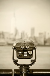 New York city, observation binoculars with downtown view and desaturated instagram filter processing