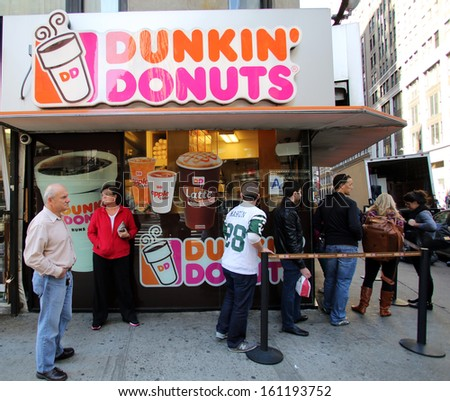 NEW YORK CITY - OCT 20 2013: People line up for coffee and donuts at a Dunkin\' Donuts store in Manhattan on Sunday, October 20, 2013.