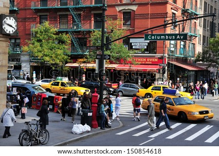 NEW YORK CITY - OCT 17 2009:Traffic on Ninth Avenue and Columbus Avenue in New York,USA.Former president Bill Clinton initiated a project to revitalize the 9th Av corridor around Hell's Kitchen area