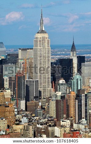 NEW YORK CITY - OCTOBER 13:  Aerial view of Manhattan and Empire State Building on October 13, 2009, New York. The Empire State Building is a 102-story landmark and American cultural icon in New York.