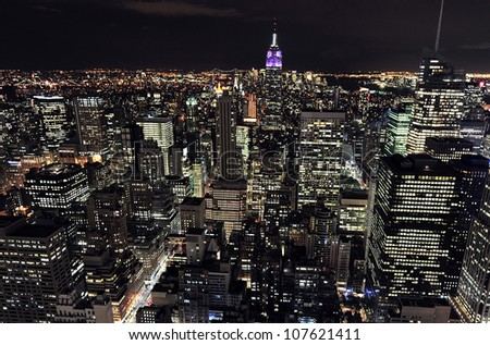 NEW YORK CITY OCTOBER 13 Aerial view on Manhattan and Empire State Building at night on October 13 2009 in New York The building is a 102-story landmark and American cultural icon in NYC