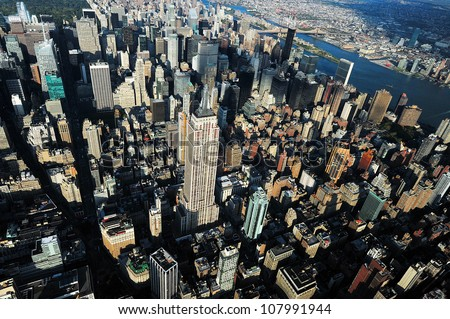NEW YORK CITY - OCTOBER 13: An aerial view of the Empire State Building on October 13, 2009 in New York.The building is a 102-story landmark and American cultural icon in New York City.